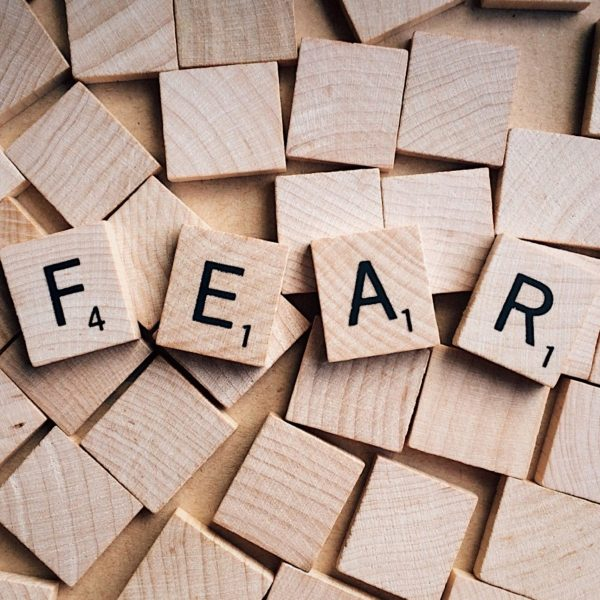 Canva - Word Fear Written on Wooden Scrabble Letters
